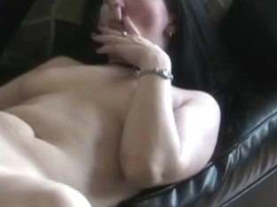 Brunette babe sucking cock while smoking