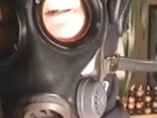 jizz flow on woman in gasmask
