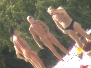 Blonde naked babe with shaved pussy on public beach nudist exposure