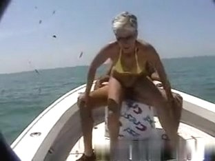 Milf rides her husband on a boat on sea