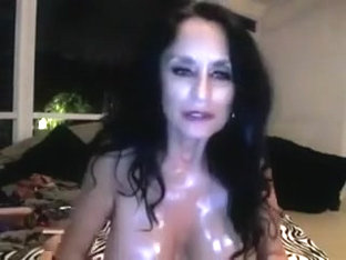 Crazy brunette woman oils her body and toys her twat in webcam solo clip