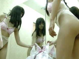 Asian cutie gets ready for her lesson in changing room