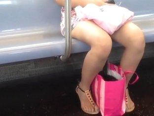 Candid train feet in thong sandals