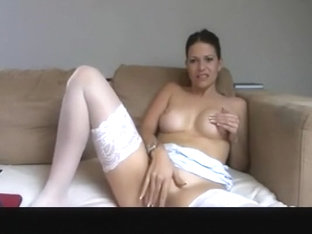 German babe masturbates on sofa