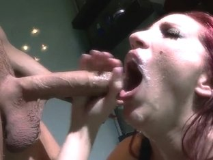 Kelly Divine sucking off Clover's cock.