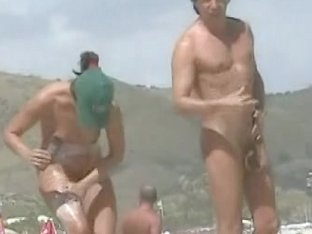 Naked babes caught on the voyeur camera relaxing on the beach