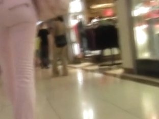 Pink beauty gets followed  by a voyeur with a spy cam