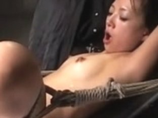 Tied up Asian female in a hot ejaculation video