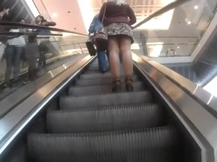 upskirted in the shopping mall rolling stairs