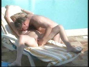 Mom and dad having fun near swimming pool. Hidden cam