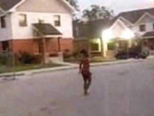 Curly black slut walks naked around the neighborhood
