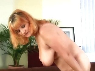 Breasty granny likes toying her old and shaggy cunt
