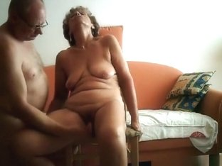 Milf gets masturbated with a dildo and gives her man a handjob