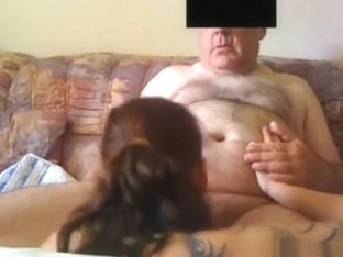 Old man gets a blowjob from a young streetslut on the sofa