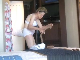 Small boobs granny caught in bedroom dressing