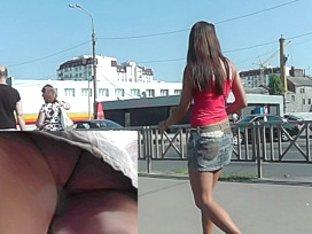 Short jean skirt slightly covers sweet ass upskirt