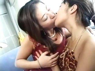 Lovely Japanese babes enjoying Sapphic kisses