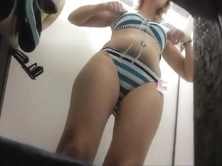 Woman trying a marine bikini on her curves