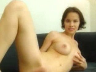 Short-haired babe inserting a metal toy in her ass