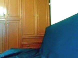 Hot dark haired girl teases naked on the sofa