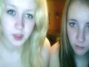 A blonde and brunette girl fool around naked on cam