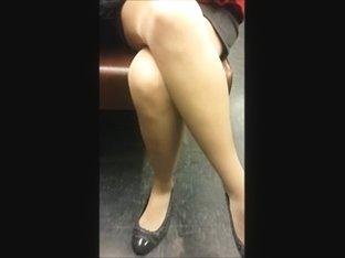 Passenger in shiny tan pantyhose