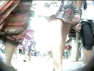A public voyeur enjoys looking at hot asses upskirt.