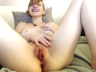 Redhead cam girl plays with her holes