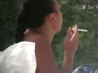 Smoking hot nudist girl is talking on phone on voyeur cam