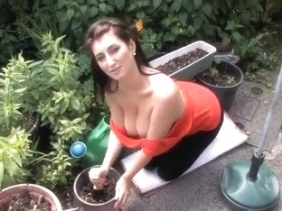 Sexy brunette gardener flashes her big natural tits
