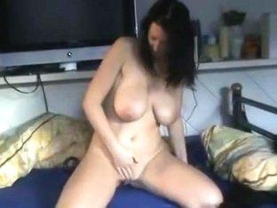 Busty babe rubs herself hard