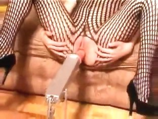 huge redhead in fishnet masturbates with dildo