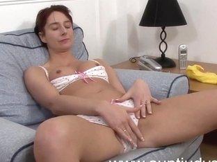 Milf Gina takes off her pink shorts and masturbates.