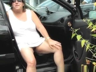 Exhibitionist mature exposing pussy in parking