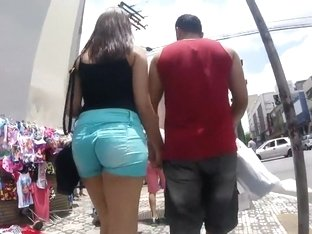 Hot ass in tights on the moving stairs