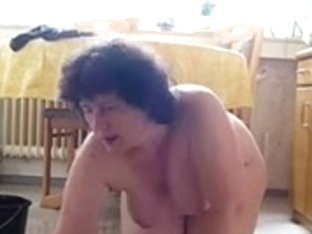 Fat wife mops the floor in kinky voyeur masturbation video
