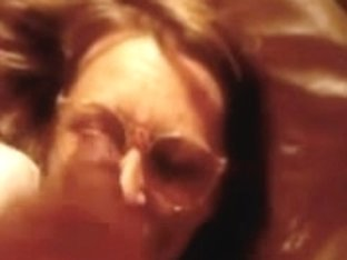 Darksome cock empty his balls all over her face & glasses