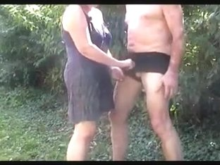 I spank my hubby's butt and rub his dick in the garden