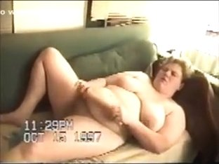BBW busty white wife on the couch fondles herself with a stick