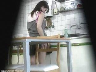 Caught woman masturbates in kitchen