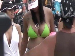 Big tits jiggling in bikini as she moves