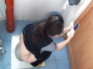 Toilet voyeur video of Asian girl pissing in restaurant