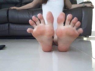 Angel Points Her Toes in Flip Flops