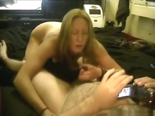 Blonde gives her man a pov blowjob on the waterbed