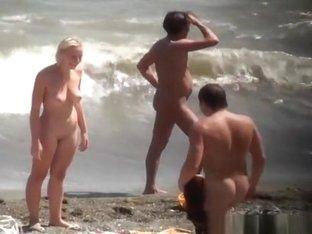 Nudist blonde woman caught in nudist beach
