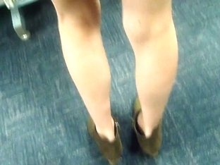 Slim blonde MILF upskirted in the library