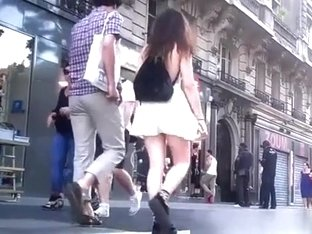 Wind lifts teen skirt