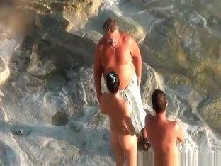 Nudist couple handjob and pussy eating