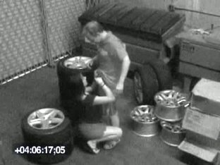 Guy packs babe in mouth and pussy on candid camera in the garage