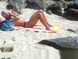 Oiling milf on the beach